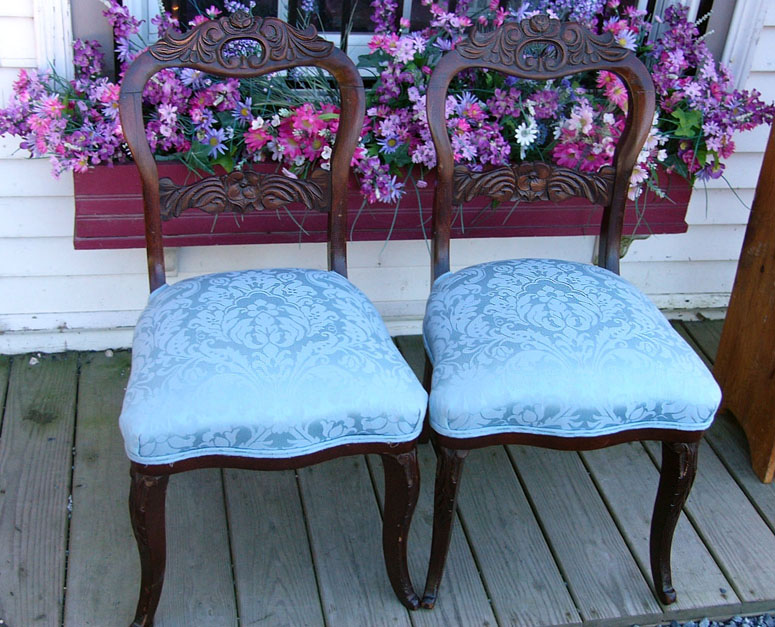 two blue victorian chairs